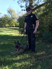 Deputy James Tennyson and K9 Jary Standing in Forest Area